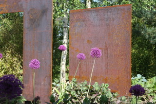 Garden Trio  Steel Sculpture with allium in a garden near Wetherby in Yorkshire by Paperbark Garden Design