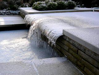 Garden landscaping water feature in ice near Wetherby, North Yorkshire side view
