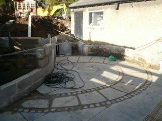 hard landscaping with retaining wall built