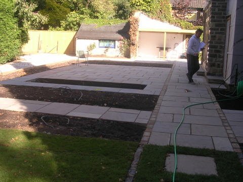 Garden outdoor dining area at Leeds, Yorks stone patio terrace