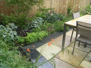 garden landscaping with lush planting and outdoor dining in yorkshire