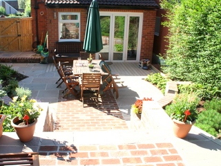 Garden after complete design and landscaping at Roundhay in Leeds, Yorkshire. Terrace and old Garage