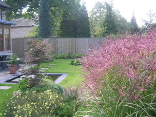 garden landscaping with prairie planting and water feature for garden in Leeds