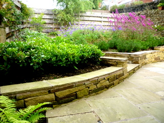 garden landscaping for courtyard at denby dale near wakefield york stone wall with indian stone copings