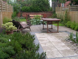 Garden landscaping long terrace garden with decking paving by Paperbark Garden Design Yorkshire UK