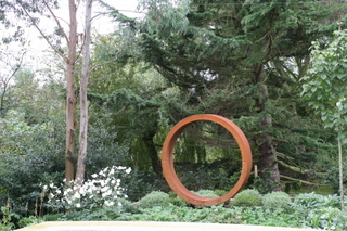 Garden Ring Steel Sculpture in a garden near Wetherby in Yorkshire by Paperbark Garden Design