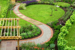 landscaped garden design for long garden in north yorkshire curved path and pergola - Garden Design Uk