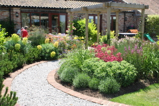 Garden landscaping at Large Country Cottage Garden near Selby mid view