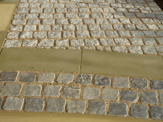 Stone setts path with Yorkshire paving at landscaped garden by Paperbark Garden design