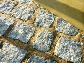 Texture of Stone setts with Yorkshire paving at landscaped garden by Paperbark Garden design