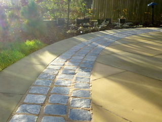 Stone setts with Yorkshire paving at landscaped garden by Paperbark Garden Design
