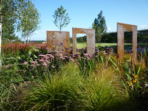 Garden Trio  Steel Sculpture Design in a garden near Wetherby in Yorkshire by Paperbark Garden Design