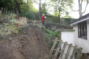 Surveying a steep Garden at Baildon, West Yorkshire.